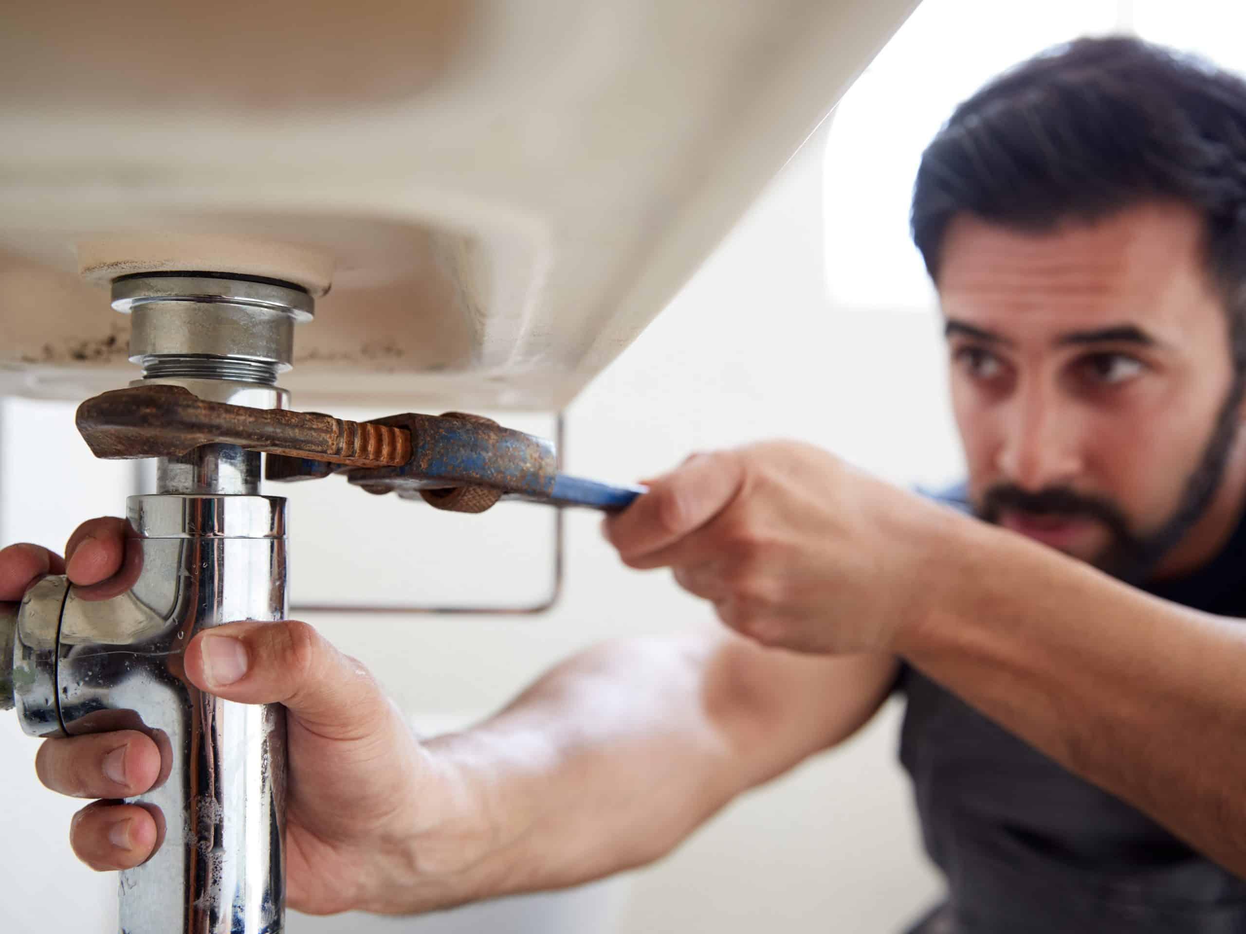 plumbing service profesional fixing sink