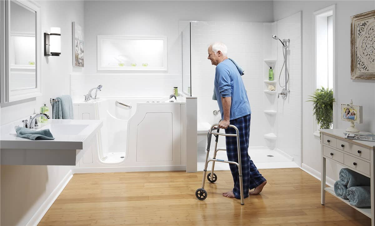 older man walking with aid to walk in tub